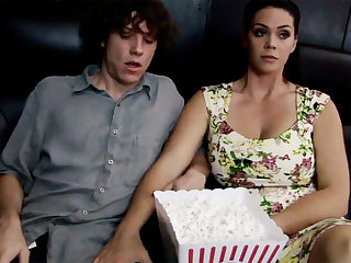 Oversexed milf touch shy stepson's dick in cinema