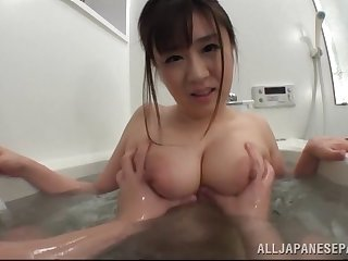 Hot Japanese babe getting titty fucked on every side the bathtub