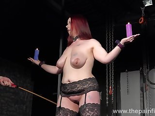 Chubby redhead has to endure some kinky chastisement in the dungeon