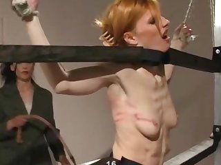 Extreme torture added to spanking between a dominant lady added to her slave