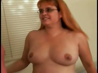 Perverted amateur redhead housewife in glasses sucks a handful of dicks in request