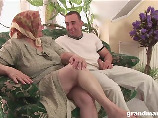 Dirty granny with huge saggy tits fucks a young man